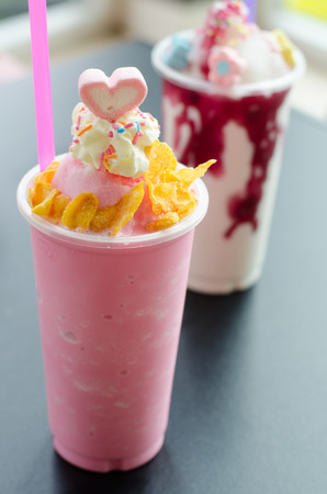 Iced  strawberry milk shake whipped topping on the top with Marshmallows