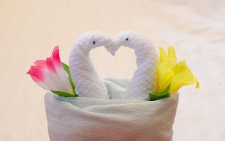 Swan towel decoration on bed Stock Photo