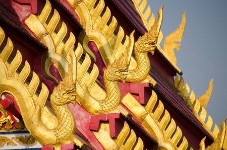 wat pho: Beautiful Nagas or Serpents (Giant snake) statue on the top of roof in Wat Pho Sri Som Phothi in Loei province , Thailand