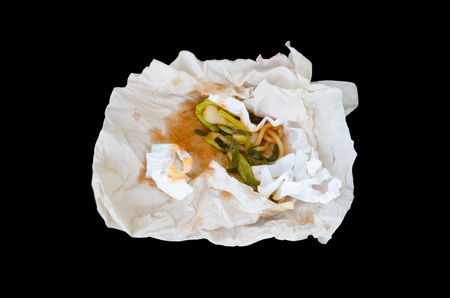 tissue paper wraping waste food isolated on black background stock