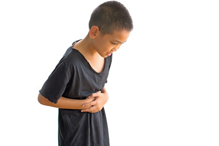 Asian boy with problems stomach ache isolated on white background