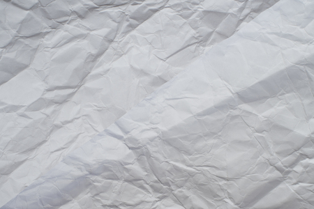 Paper texture. White crumpled paper background.