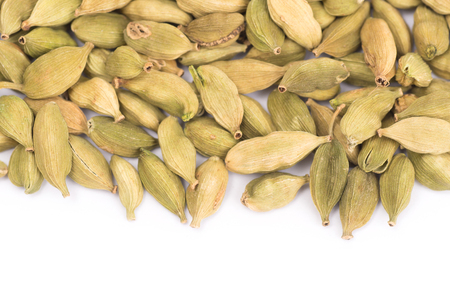 Pile of green Cardamom, cardamon isolated on white background (dried fruits of Elettaria cardamomum) 写真素材