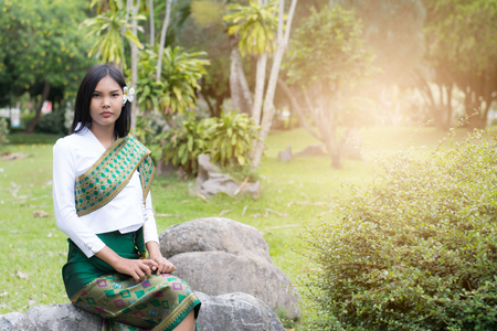 Beautiful Laos girl in Laos costume ,Asian woman wearing traditional Laos culture,vintage style,traditional suit.