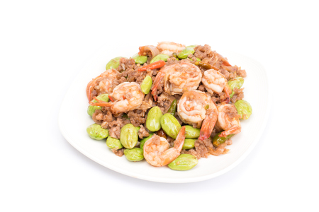 Spicy stir-fried shrimp with bitter or twisted cluster or stink bean (Bitter Bean) and shrimp paste isolated on white background