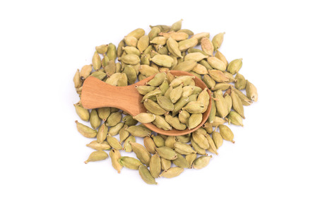 Pile of green Cardamom, cardamon or cardamum  isolated on white background (dried fruits of Elettaria cardamomum 写真素材
