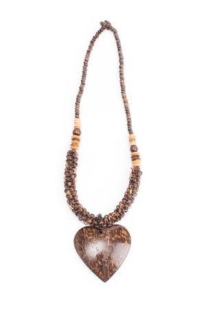 A handmade coconut shell necklace on a white background.