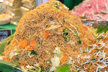 Fried instant noodles. Street food in Thailand