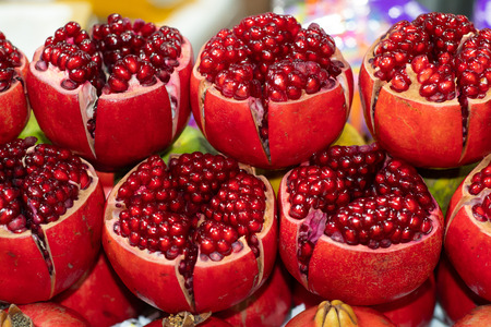 Thai fruit, Ripe Pomegranate, Pomegranate background, Tubtim is thai call, Some cuts in half to show the freshness, In Fruit Market