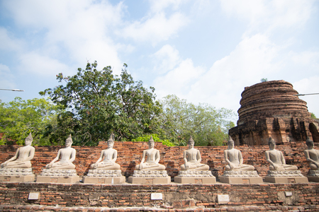 Row of Buddha statues in Wat Yai Chaimongkol in Ayutthaya ,Thailand
