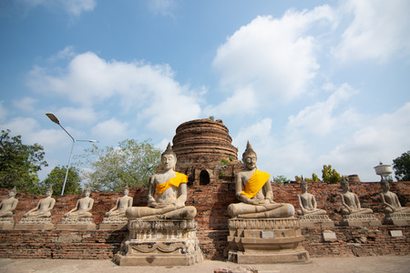 Ancient statues of meditating buddha sitting, at Wat Yai Chaimongkol old temple in Ayutthaya, Thailand