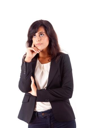 sideways: Beautiful business woman thinking over white background Stock Photo