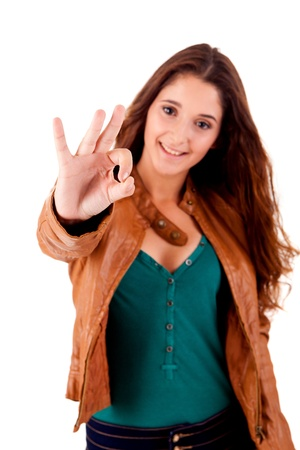 Beautiful young woman doing ok over white background photo