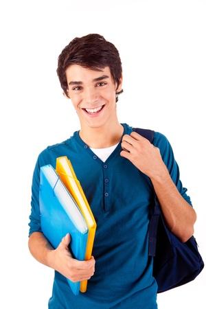beau jeune homme: Jeune �tudiant heureux portant des livres sur le backgound blanc