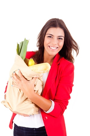 Young female holding a shopping bag on white background  photo