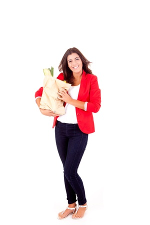 Young female holding a shopping bag on white background  Stock Photo - 17148181