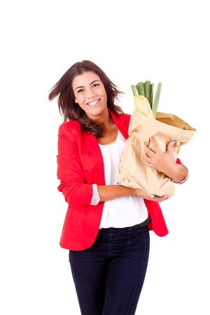 Young female holding a shopping bag on white background Stock Photo - 17159889