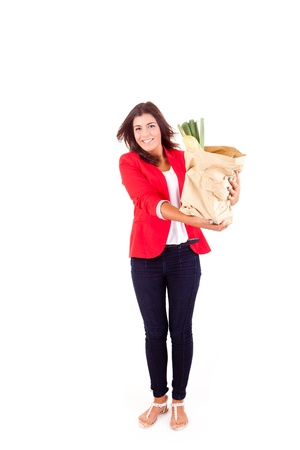 Young female holding a shopping bag on white background  Stock Photo - 17148179