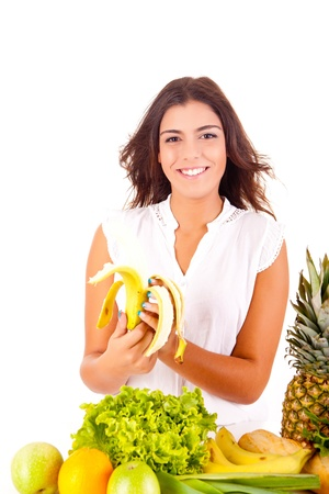 Happy young woman with fruits and vegetables on white background Stock Photo - 17159911