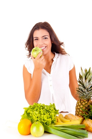 Happy young woman with fruits and vegetables on white background photo