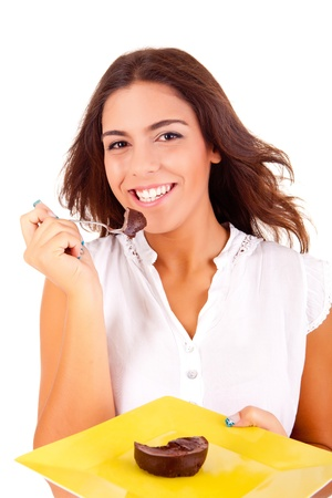 entice: Young woman eating chocolate cake on white background Stock Photo