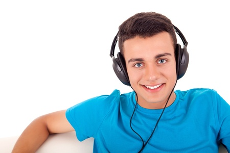 Beautiful young man listening to music on his headphones