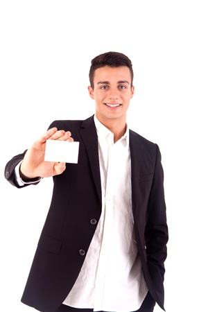 Young business man handing a blank business card over white background photo