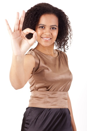 Portrait of young business woman doing Ok sign Stock Photo - 17160049