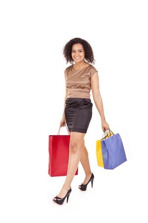 Beautiful african woman holding shopping bags Stock Photo - 17243803