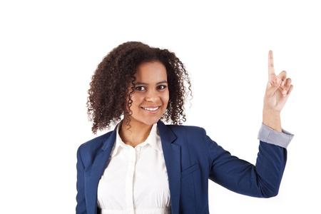Portrait of young beautiful woman pointing up at copyspace over white background Stock Photo - 17159982