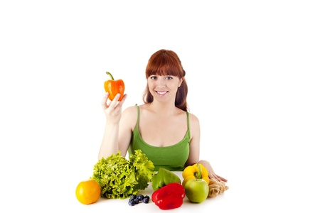 Happy young woman with vegetables. Isolated over white. Stock Photo - 17159975