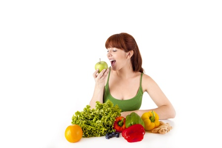 Happy young woman with vegetables. Isolated over white. Stock Photo - 17159979
