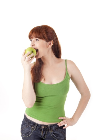Beautiful young woman eating apple on white background Stock Photo - 17160033