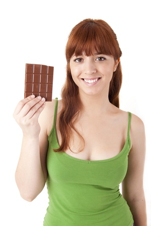 Beautiful young woman holding chocolate on white background photo