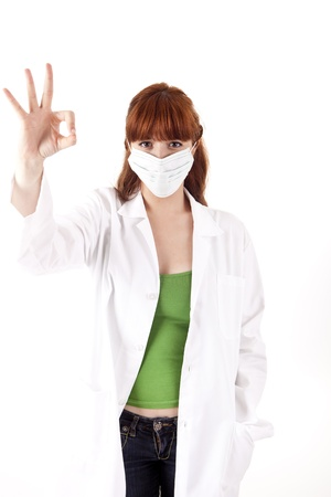 Young doctor signaling ok on white background Stock Photo - 17159971