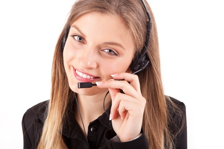 Beautiful call center employee smiling with a headset over white photo