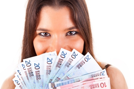 woman holding money: Portrait of a happy woman with a fan of Euros currency notes