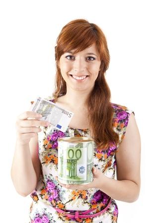 Beautiful woman saving money on white background photo