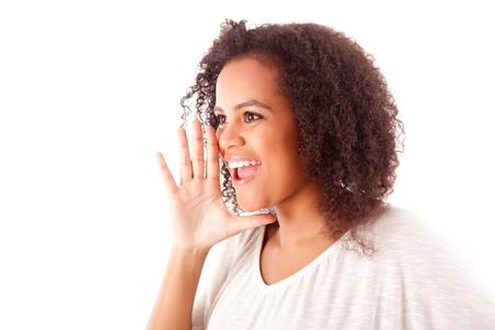 Beautiful african woman calling someone Stock Photo