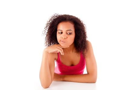 Beautiful african woman thinking Stock Photo - 17160028