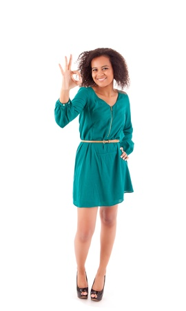Beautiful afro woman doing ok sign photo