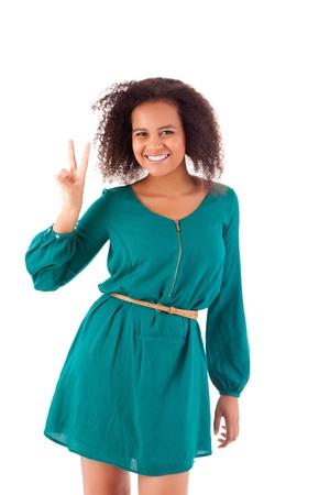 Bid: Beautiful african woman showing peace sign