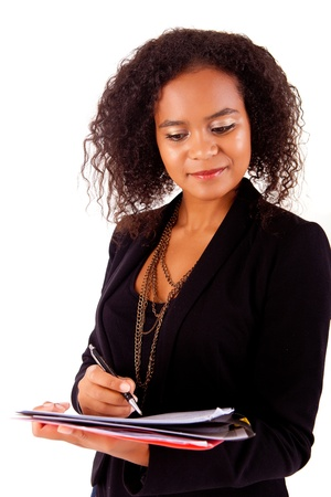 Beautiful african woman scheduling an appointment Stock Photo - 17243322