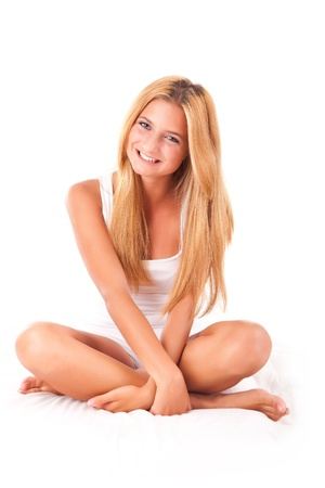 girl sit: Beautiful blond girl relaxing in bed