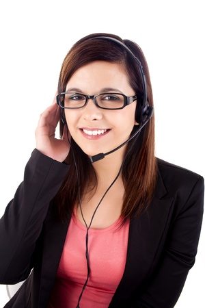 Portrait of a happy young call centre employee smiling with a headset over white photo