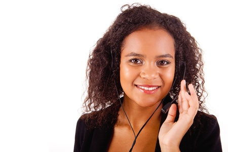 Beautiful african call center woman at work smiling with headset  Stock Photo - 17347591