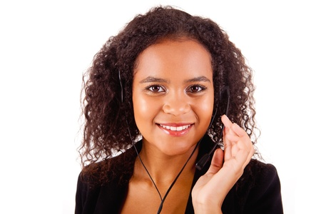 Beautiful african call center woman at work smiling with headset Stock Photo - 17347590