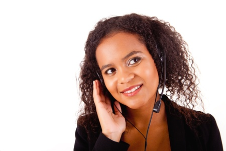 Beautiful african call center woman at work smiling with headset  Stock Photo - 17347589