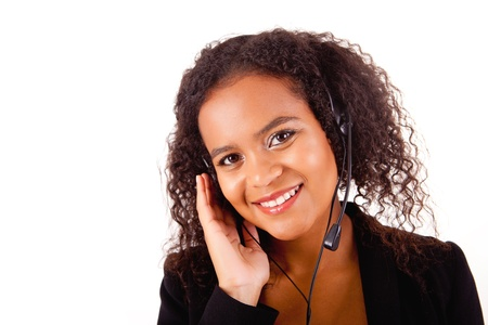 Beautiful african call center woman at work smiling with headset  Stock Photo - 17347588