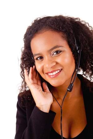 Beautiful african call center woman at work smiling with headset Stock Photo - 17347613